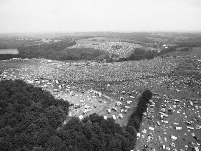 "This is an aerial photo of the Woodstock Music and Arts Festival held on 600 acres of cow pasture leased from a farmer at White Lake in Bethel, Sullivan County, N.Y., in Aug. 1969.  The festival, billed as ""Thee Days of Peace and Music,"" started on Friday, Aug. 15 and ended Monday morning, Aug. 18.  More than 450,000 persons attended.  (AP Photo/Steve Starr)"