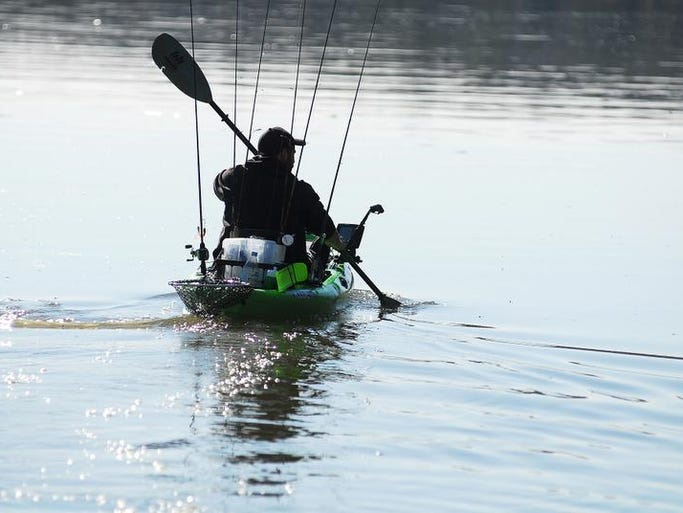 Jimmy DiTraglia paddles his way out to compete in the Michael Ernst Whizz Kidz Charity Kayak Fishing Tournament on the Cumberland River in Gallatin on Saturday Feb. 22.