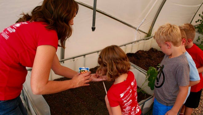 Crimson View Elementary students are gardening in the school's greenhouse to better understand STEM.