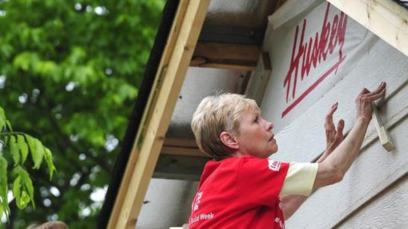 Linda Krohn and Mary Byland put on siding as a group of women from Brentwood United Methodist Church team up with Lowe's to construct a Habitat for Humanity house in Franklin in recognition of National Women Build Week in 2011. Larry McCormack / File / The Tennessean