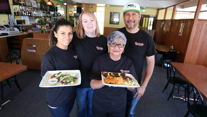 Ricardo Ramirez-Rodriguez is photographed with his wife, Dee Anna Ramirez, second from left; his niece, Abi Lopez, and his mother, Minerva, on Wednesday, Sept. 28, 2016, at Romana's Mexican Restaurant in NE Salem. Ramirez-Rodriguez opened the restaurant with his wife and niece, and named the restaurant for his late grandmother. The family-run business features authentic Southern Mexican dishes.