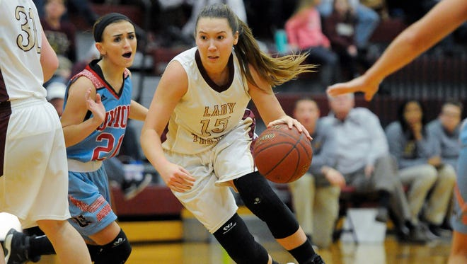 Webster County's Kaylee Duncan (15) drives past Union County's Victoria French (21) during their game at Webster County High School in Dixon, Friday, Jan. 6, 2017.