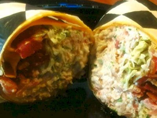 Mig's Applewood Smoked Chicken BLT Wrap contains diced