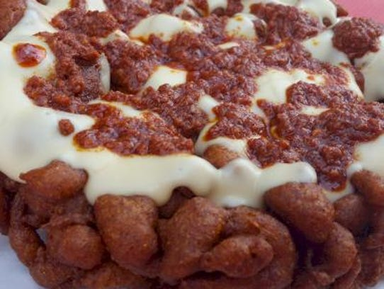 Corn meal batter flavored with enchilada spices, the