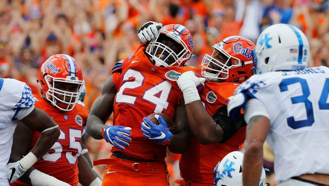 Sep 10, 2016; Gainesville, FL, USA; Florida Gators running back Mark Thompson (24) is congratulated after he scored a touchdown against the Kentucky Wildcats during the first quarter at Ben Hill Griffin Stadium. Mandatory Credit: Kim Klement-USA TODAY Sports