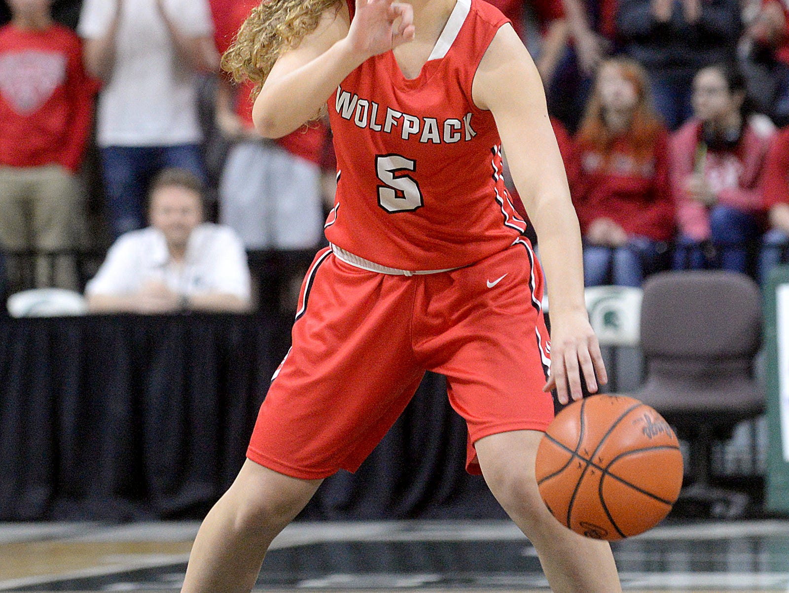 Guard Julia Angst calls out a play for Laingsburg during their Class C State Semifinal matchup against Calumet Thursday, March 19, 2015. Calumet won 30-26 to advance to Saturday's state final agains Flint Hamady.
