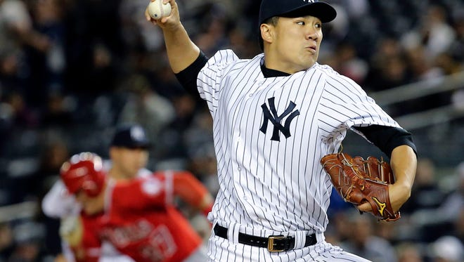 Yankees pitcher Masahiro Tanaka throws in the first inning against the Angels on Sunday night.