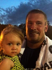 Joe Reitz with daugher Juliana after Colts practice in 2012.