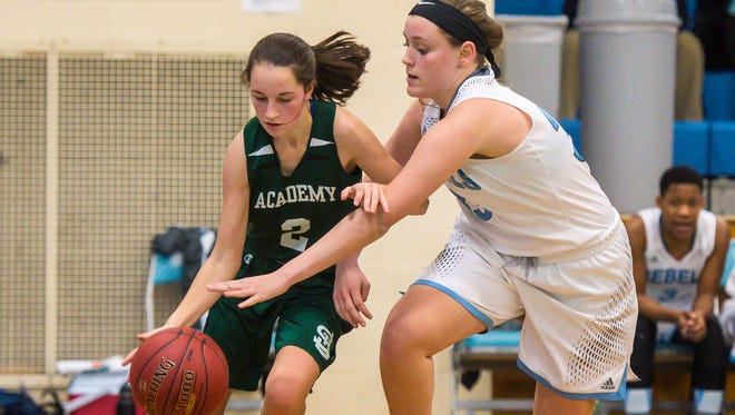 South Burlington's Emma MacDonough, right, pressures St. Johnsbury Academy's Kayla Matte in South Burlington on Friday, January 6, 2017.