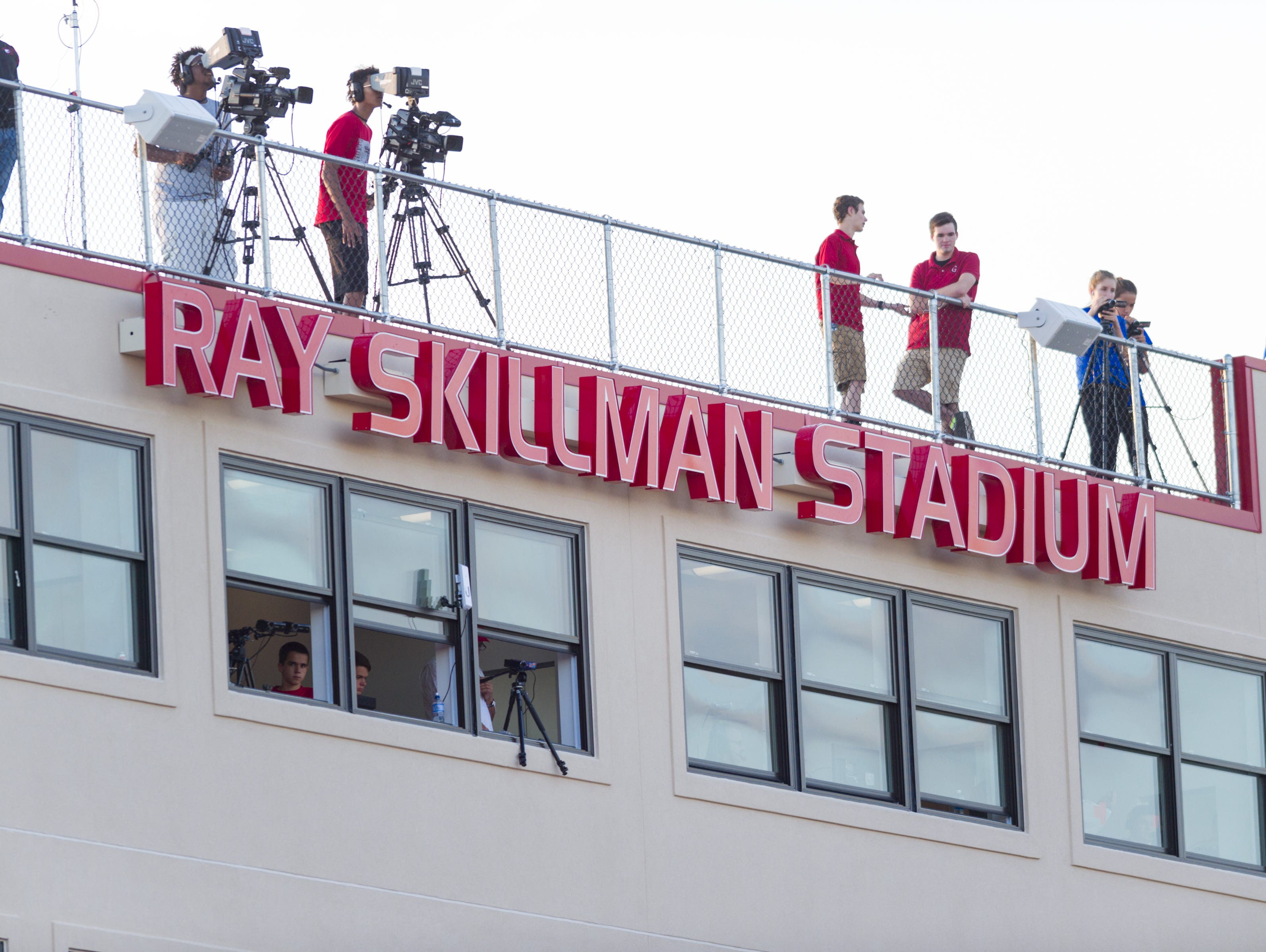 The press box at Center Grove High School shows the major sponsorship the school has for the program during the first half of an IHSAA varsity football game, Friday, Sept. 2, 2016, at Center Grove High School.
