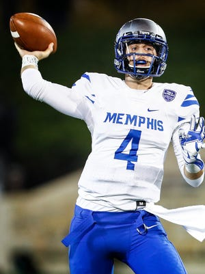University of Memphis quarterback Riley Ferguson throws a touchdown pass against the University of Tulsa defense in Tulsa, Okla., on Nov. 3, 2017.