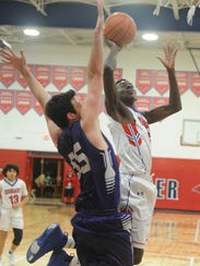 Cooper's Matthew Falade, right, drives to the basket