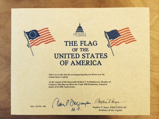 """A Certificate from the Architect of the Capitol, Stephen T. Ayers, states that a flag was flown in honor of Cedar Hill Elementary School's 50th Anniversary over the United States Capitol. U.S. Rep. Rodney P. Frelinghuysen requested the honor and sent the flag to the Montville Township Public School. The Congressman signed the certificate and added an """"M.C."""" for Morris County."""