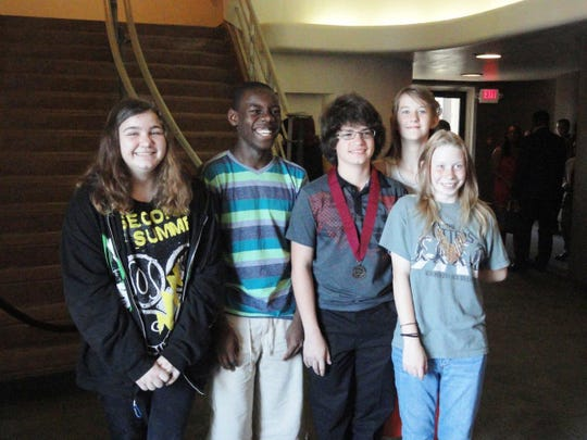 Preston Wilburn (third from right), 13, stands with his classmates from Montessori Education Center in Alexandria at a ceremony recognizing him and other Louisiana seventh-graders who scored at or above the national average of recent high school graduates on at least one part of the ACT. His score of 22 earned recognition from the Duke Talent Identification Program at the state ceremony at Northwestern State University on May 4. From left are Ansley Greer, Ellis Chinagozi, Preston, Emma Sullivan (back) and Kaitlyn Huff.