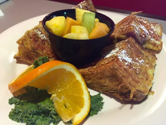 Men Wielding Fire offers a Monte Cristo Sandwich for $11.99 during its breakfast hours. It comes with a cup of fruit.