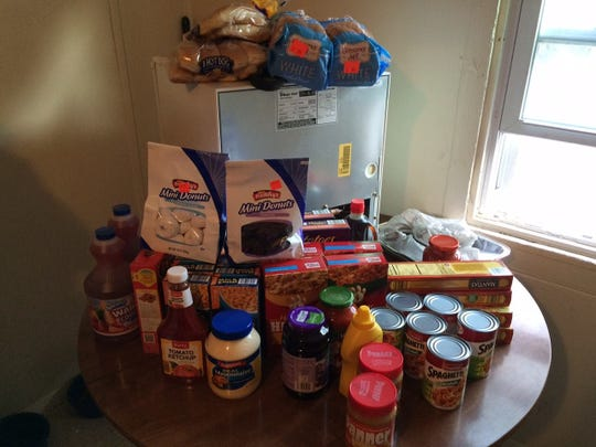 Bridgeton Police Department officers help out a local family by donating groceries and a refrigerator.