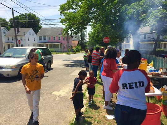 The outdoor barbeque to celebrate Jerame C. Reid's