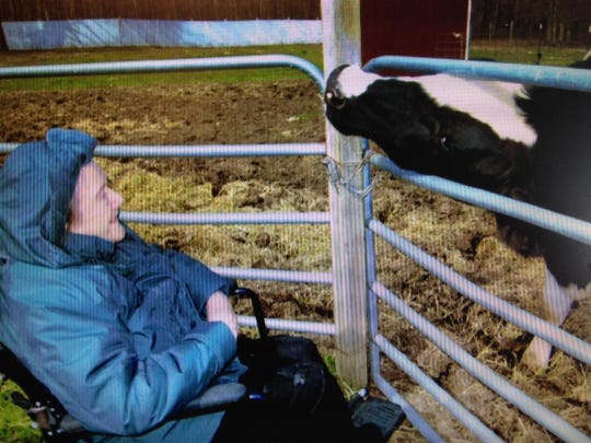 Helen Hugo with the cow of her niece, Barbara Martin.
