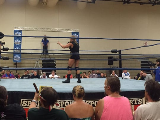Wrestler Alexander Hammerstone speaks to the crowd in the ring at Houck Middle School on July 5, 2015.