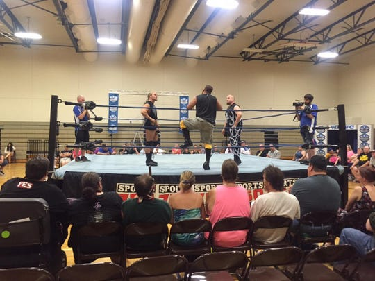 Wrestlers heckle each other in the ring at Houck Middle School on July 5, 2015.