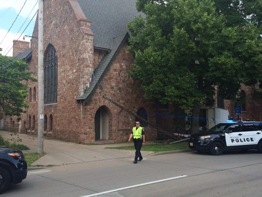 A Wausau police officer helps at the scene of the crash.