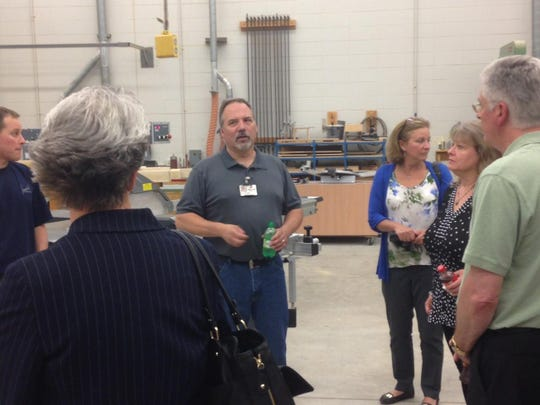 Mark Lorge, wood manufacturing instructor, addresses a field of wood manufacturing professionals during a tour of Fox Valley Technical College in Oshkosh.