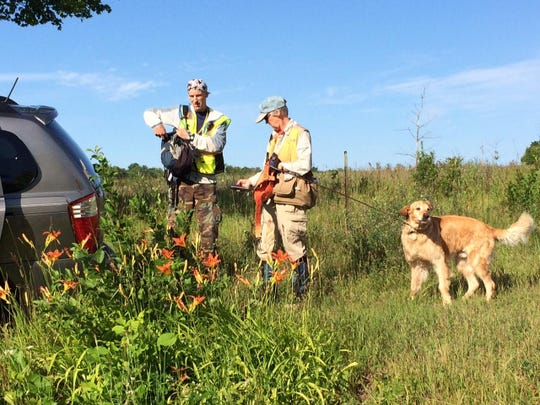 Headwaters Search and Rescue volunteers Karen and Tom head out with Dex in search of missing Grand Chute doctor Jeffrey Whiteside. They searched a meadow along County Q and Wisconsin 57.
