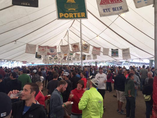 Festivalgoers congregate under a tent Saturday at the Oregon Brewers Festival in Portland. The festival continues today.