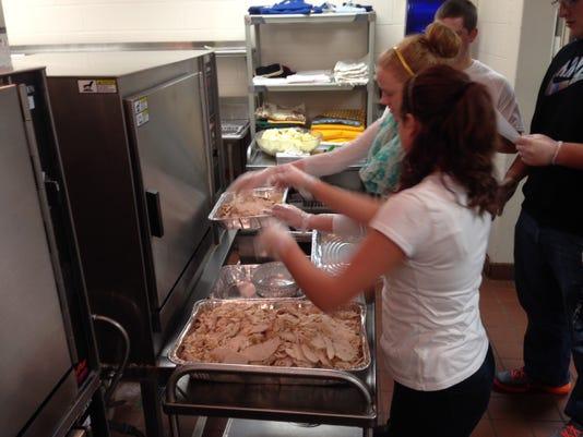 Kennard-Dale students preparing Thanksgiving meals (Photo courtesy of Gary McChalicher)