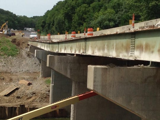 Engineers are still designing repairs to stabilize the northbound Interstate 65 bridge over Wildcat Creek near Lafayette, the Indiana Department of Transportation said on Tuesday, Aug. 25, 2015. Mid-September is the target date to fix the bridge and reopen a 35 mile section of northbound I-65 that's been closed since Aug. 7 in order to keep traffic off the unsafe structure, according to INDOT.