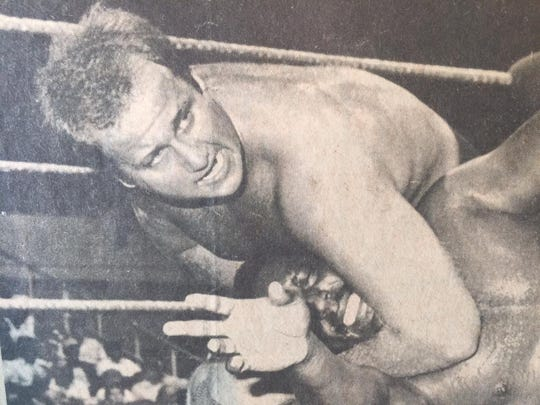 Big Ron Shaw, top, wrestles S.D. Jones in this 1981 newspaper clipping from Shaw's scrapbook.