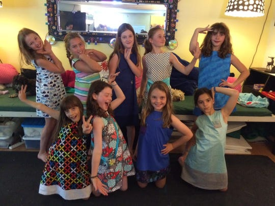 These girls just want to have fun, so they strike a pose in the dresses they designed and sewed at the Poker Hill Arts Sewing and Fashion Camp in Underhill.