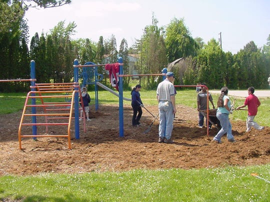 Former Lake Labish Elementary School students and staff volunteer at Labish Village Park in 2005 just outside of Salem city limits. No school has adopted the park since Lake Labish closed years ago.