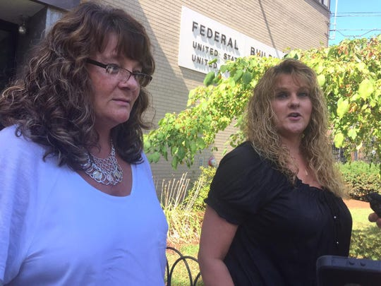 Lori Hibbard, left, and Karen Worcester, the daughters of homicide victim Terri King, speak to reporters Friday outside U.S. District Court in Burlington following a hearing for the man accused in their mother's slaying, Donald Fell.