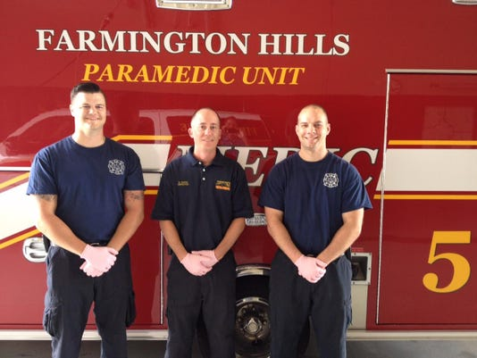 Farmington Hills Fire Fighters Wearing Pink Gloves