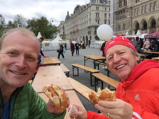"From left, David ""DocDog"" Walker and Krys Wasielewski share a meal after running the Vienna Marathon recently in Vienna, Austria."