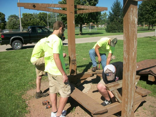 The Menasha Construction Trades students are restoring the picnic structures along the walking trail at Jefferson Park.