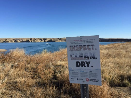 A sign reminds boaters of what to do to prevent the spread of aquatic pests. It's likely that invasive mussel larvae made its way to Tiber Reservoir on a boat, according to Montana Fish, Wildlife and Parks.
