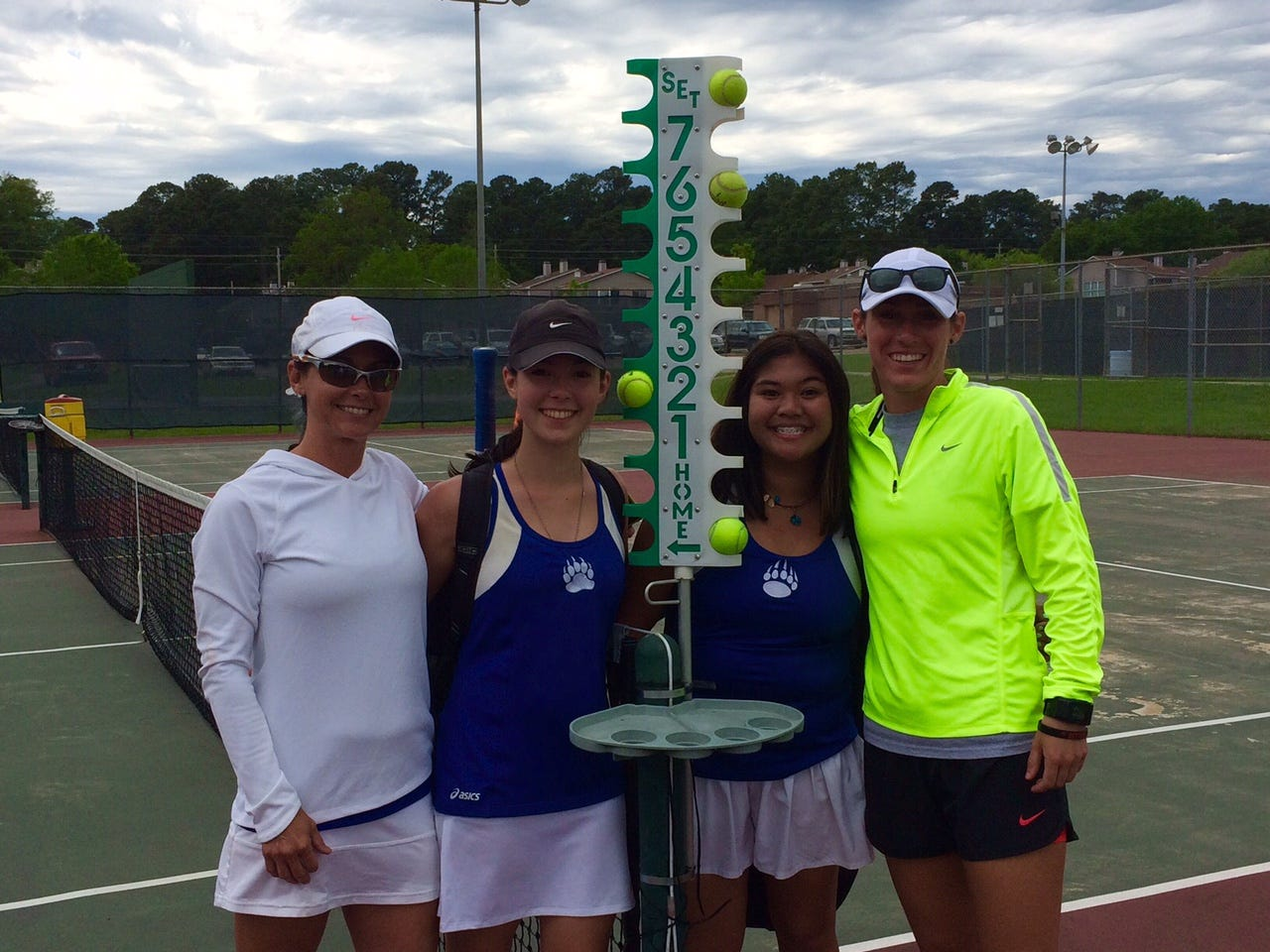 Bolton sophomre Sara Hard (second left) and freshman Alyssa Urbi qualified for the LHSAA tennis tournament after a first place finish in regionals. Also pictured Bolton assistant Christine Head (left) and coach Alex Robinson.