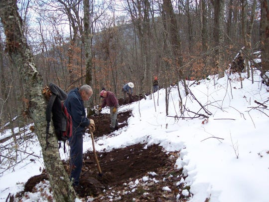 Howard McDonald, foreground, works on trail construction with other members of the Carolina Mountain Cub's Friday Trail Crew. All in the photo are older than 80 and volunteer their time to build and maintain the Appalachian and Mountains-to-Sea trails in North Carolina.