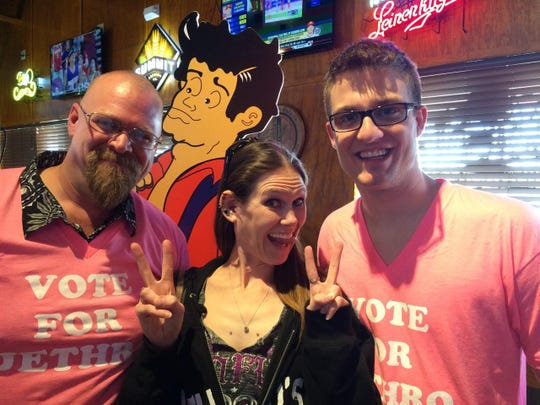 Molly Schuyler is flanked by D.J. Bacon (left) and Ethan Teske after kicking their butts at the Jethro's Emmenecker Challenge eating contest on March 30, 2015.