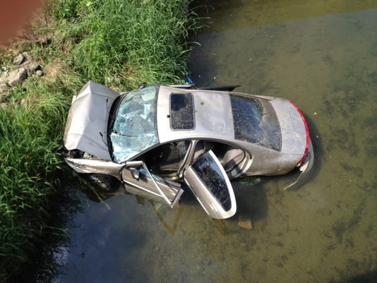 Car in creek photo 1.jpg