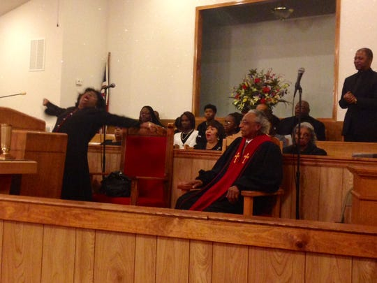 Sabrina Transou, pastor at the New Greater Bethel CME Church, shouts her sermon on peace and justice Sunday morning.