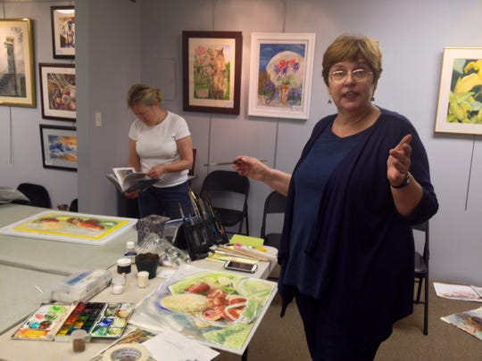 Lucy Mistratov teaches a watercolor class at the Kentucky Watercolor Society gallery and office at Brownsboro Center, Brownsboro Road and Rudy Lane. Student Rose Anne Phillips is in the background.