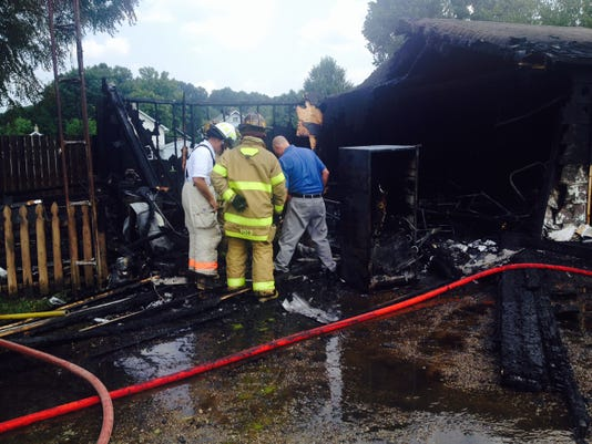 Couple loses everything in garage fire.JPG