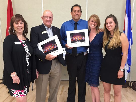 From left: Susan Francis, CEO of The Ophelia Project; Bill Powers, chairman of the board for The Ophelia Project; Rudy Ramirez, principal of Indio High; Jennifer Carlson and Enore de Montenach from Up with People.