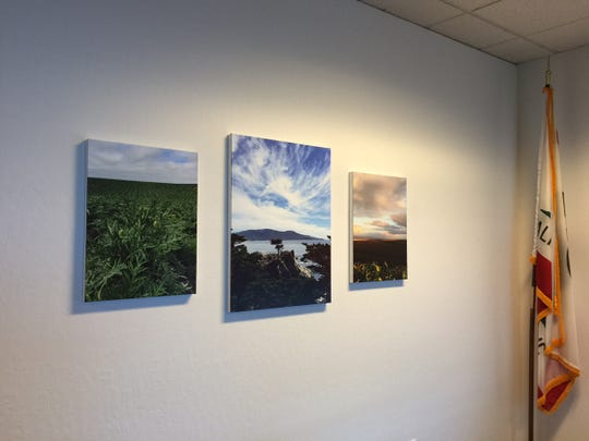 Stephen Kennedy's photos adorn the walls of the new executive conference room at the Monterey County Department of Child Support Services. Kennedy is set to retire from his directorship on Friday.