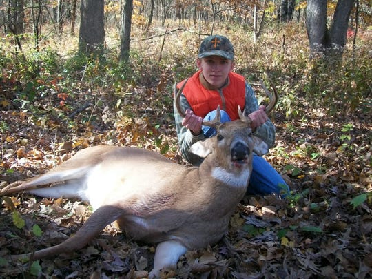 Springfield hunter Trey Lewis, 14, shot this 8-point buck on November 1 in Audrain County. Trey, a student at Logan-Rogersville MIddle School, used a .243-caliber Remington youth model rifle to kill the deer. It's the second deer he has shot, but his first buck.— Russ Lewis