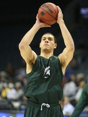 Michigan State's Gavin Schilling shoots jumpers during practice.