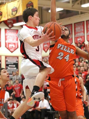 Hunterdon Central's Colin McNeil goes up for a basket as Somerville's Johnny Jimenez defends during the first quarter Saturday at Hunterdon Central.